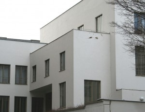 "A house philosopher Ludwig Wittgenstein designed for his sister, Margaret.  Planned and build between 1925 and 1928, the building embodies the austerity of Wittgenstein's early philosophy.  Wittgenstein insisted on custom quarry tiles, metal curtains that retracted into the floors, minimal door hardware, the complete exclusion of curtains, lamp covers and fabrics of any kind, and a garden that could only have green vegetation, without any colourful flowers.   ""I am not interested in erecting a building,"" Wittgenstein explained, ""but in ... presenting to myself the foundations of all possible buildings"" (Hide, 2008). (Photo source: Wikipedia"