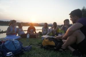 VISU members enjoy conversation at sunset along the old Danube.  (Photo courtesy of Greg Lusk)