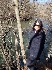 Deborah McGregor stoning beside a river
