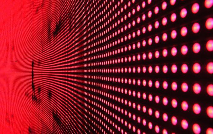 Red lights on black background
