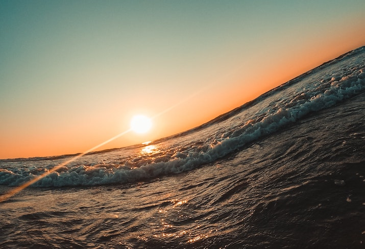 Ocean swell with setting sun in the background